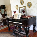 The piano in the parlor that Mr. Moore had shipped into Roseburg.